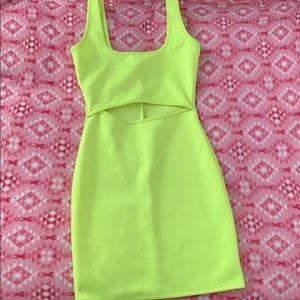Neon green body cone dress.